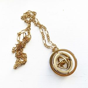 Vintage gold rotating armillary pendant necklace